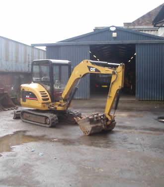 3 ton Caterpillar digger and operator